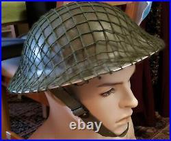 Canadian/British Helmet with netting & chin strap 1952 (Korean War Era)