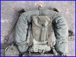 Complete WWII-Korean War M-1944 field pack upper/lower/suspenders/web belt Etc